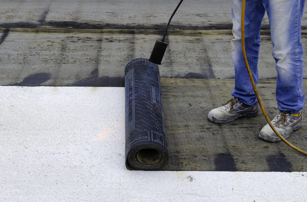 specialist waterproofing contractors applying sheet membrane