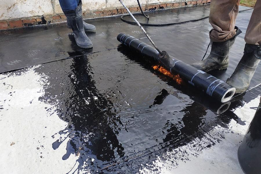 waterproofing contractor brushing membrane