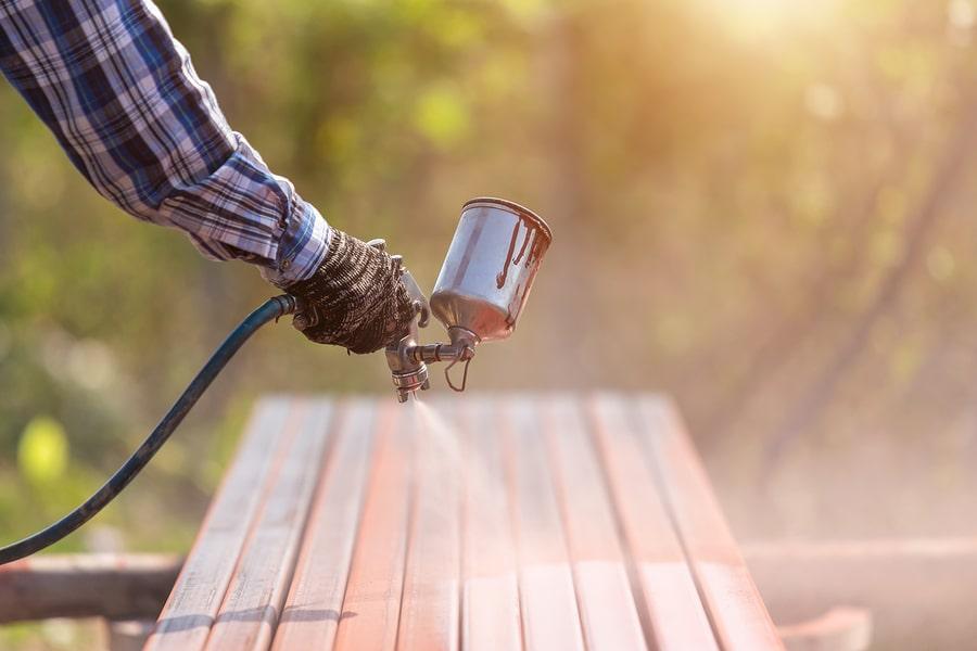 specialist waterproofing contractors spraying wood