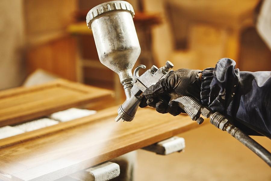 waterproofing contractor spraying wood